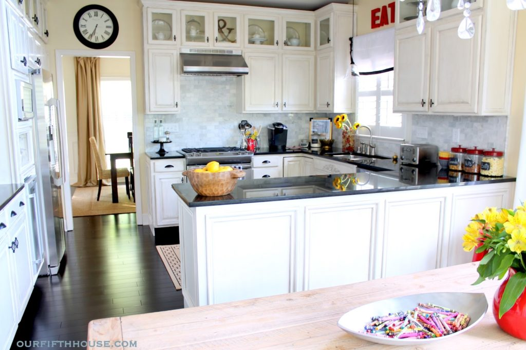 white kitchen cabinets marble backsplash