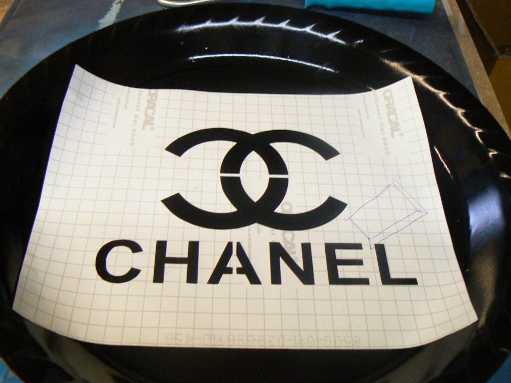 Chanel stencil on black plastic tray