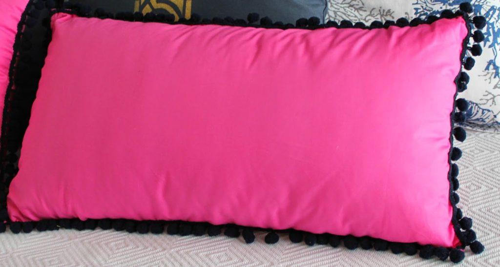 Pink pillows with pom pom