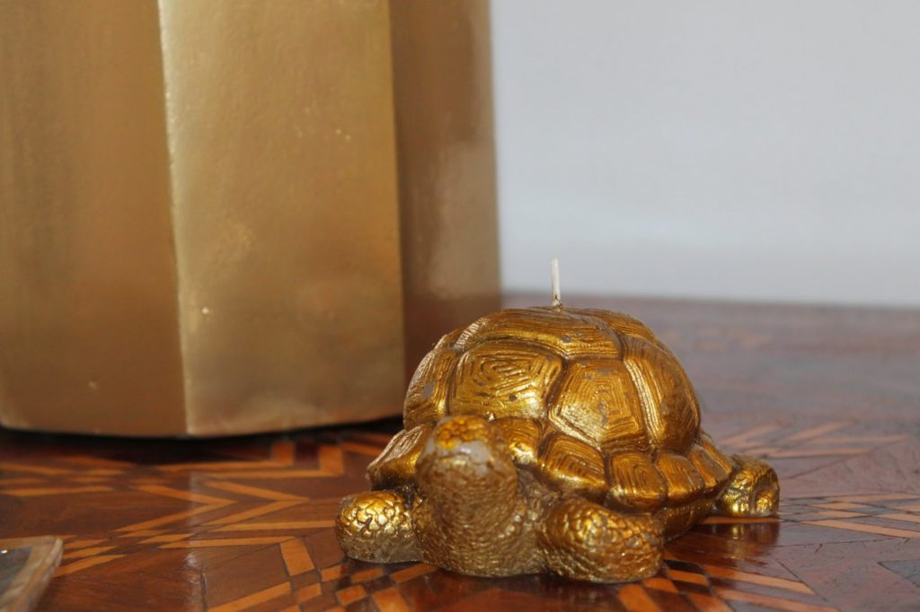 Gold turtle candle