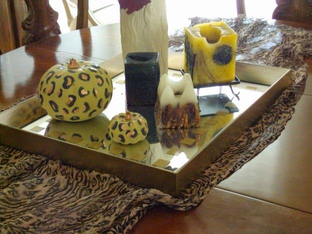 Fall tour dining room, silk animal print scarf, pumpkins and candles