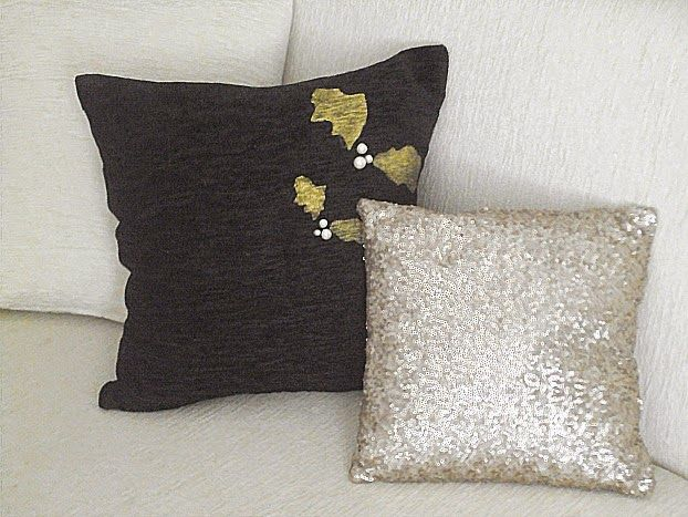 Christmas pillows in black and gold