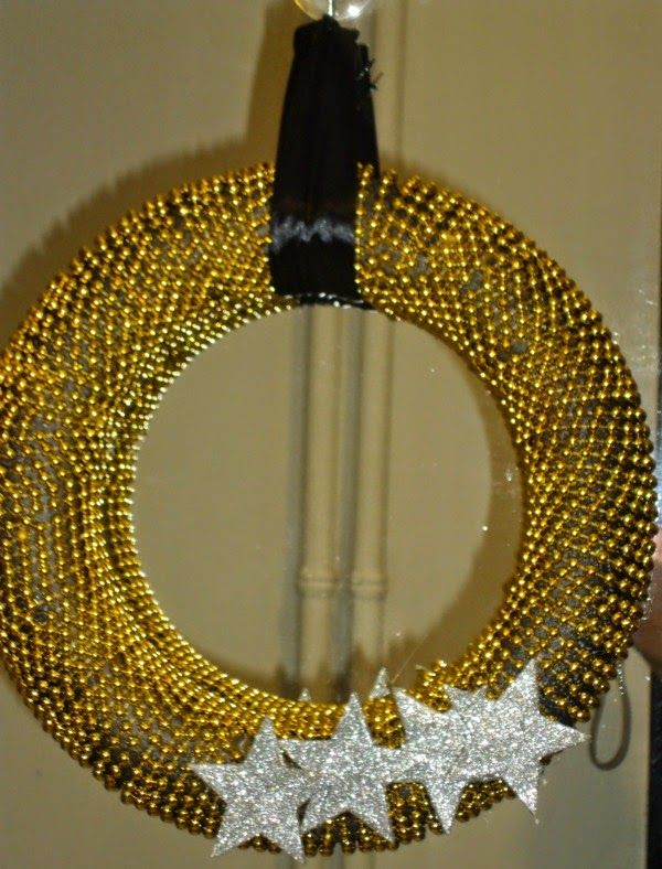 Black and gold christmas wreath, silver glitter stars
