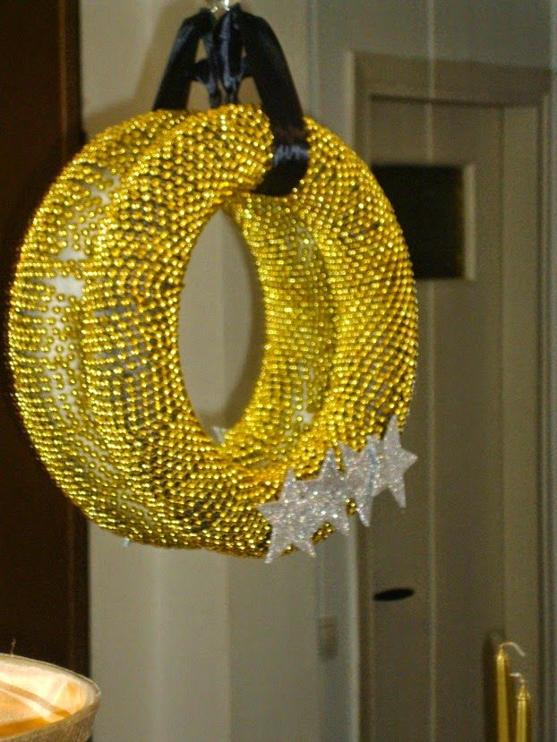 Black and gold christmas wreath on a mirror