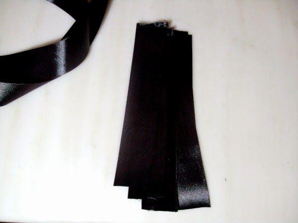 Μαύρη σατέν κορδέλα