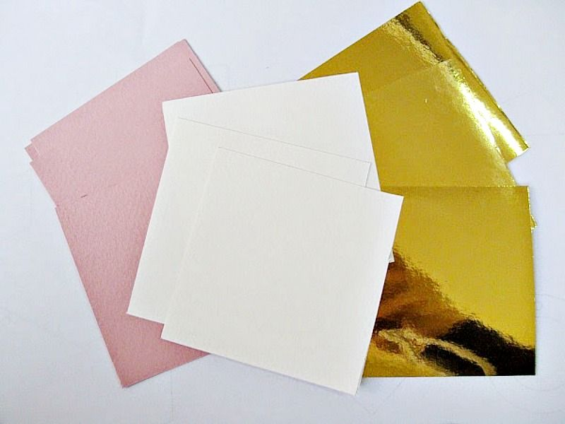 White, pink, gold, carton paper
