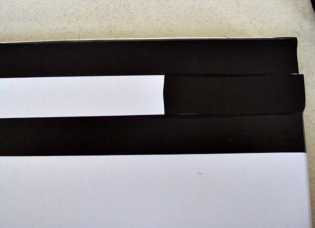Κουτιά αποθήκευσης, ρίγες με μονωτική ταινία πάνω σε λευκό κουτί