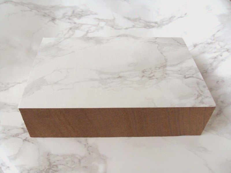 Wooden block with marble contact paper