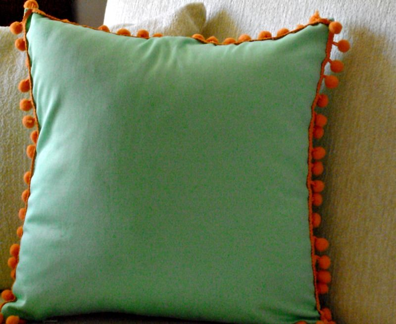 Mint orange pom pom pillow