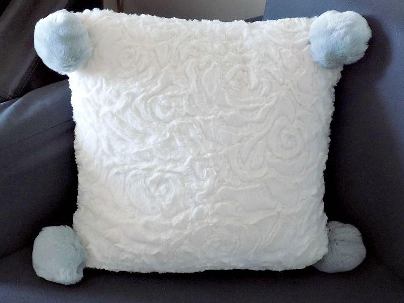 Faux fur pillow with pom pom