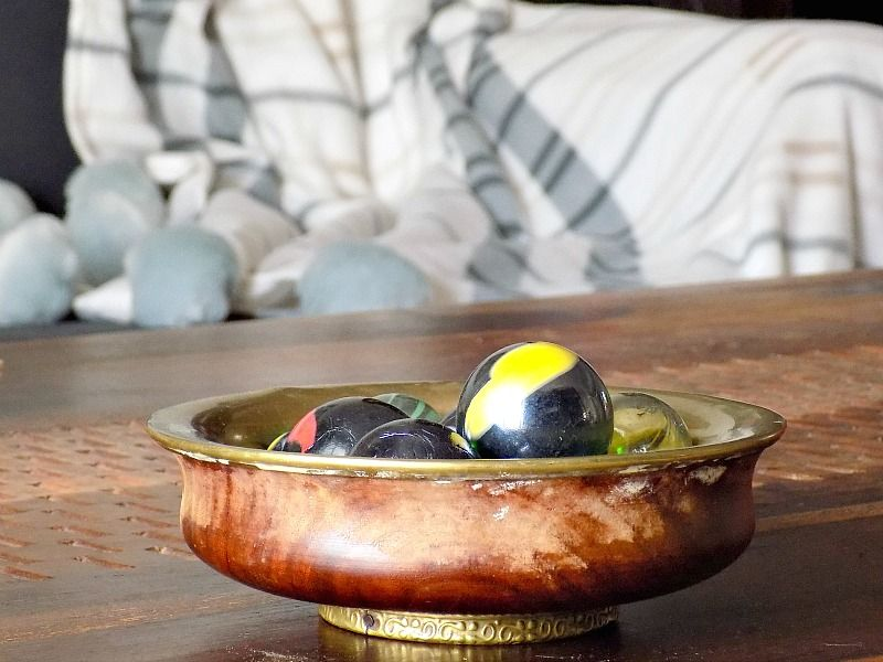 Wooden bowl with crystal balls