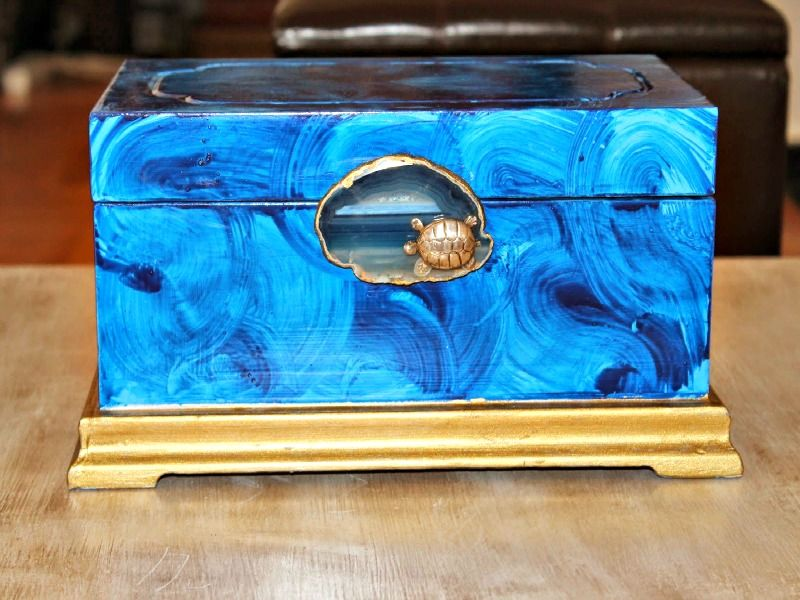Gilded agate slice on blue jewelry box