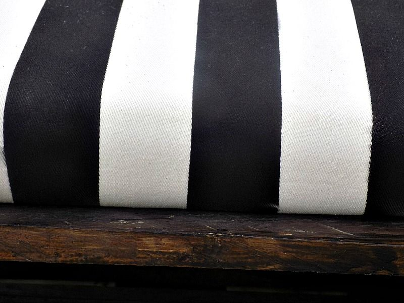 Striped pillow on pallet bench