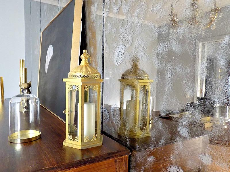 Αναπαλαίωση τοίχου-καθρέφτη, χρυσά κηροπήγια