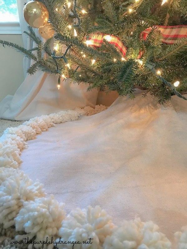 Drop cloth tree skirt with pom poms