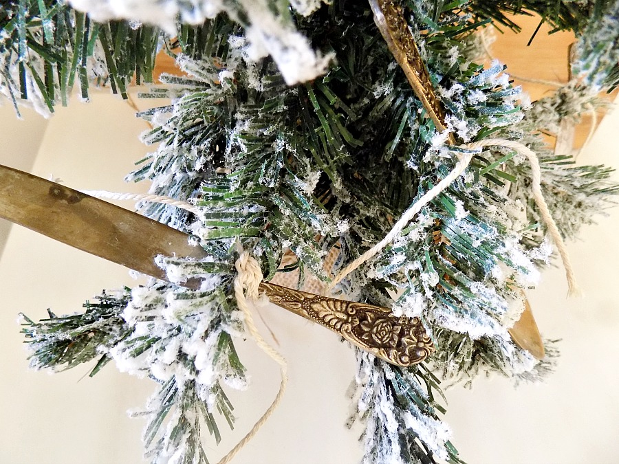 Vintage silver cuttlery on christmas tree