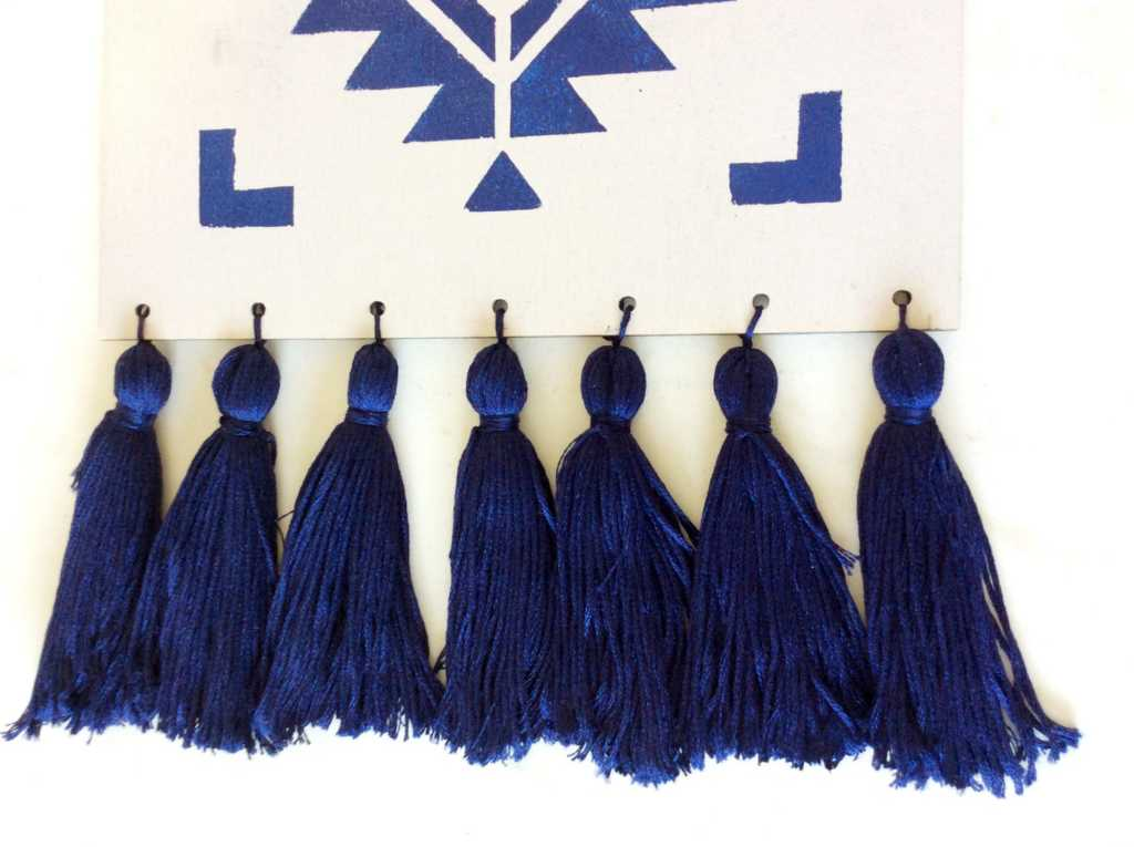 Blue tassels on boho table runner
