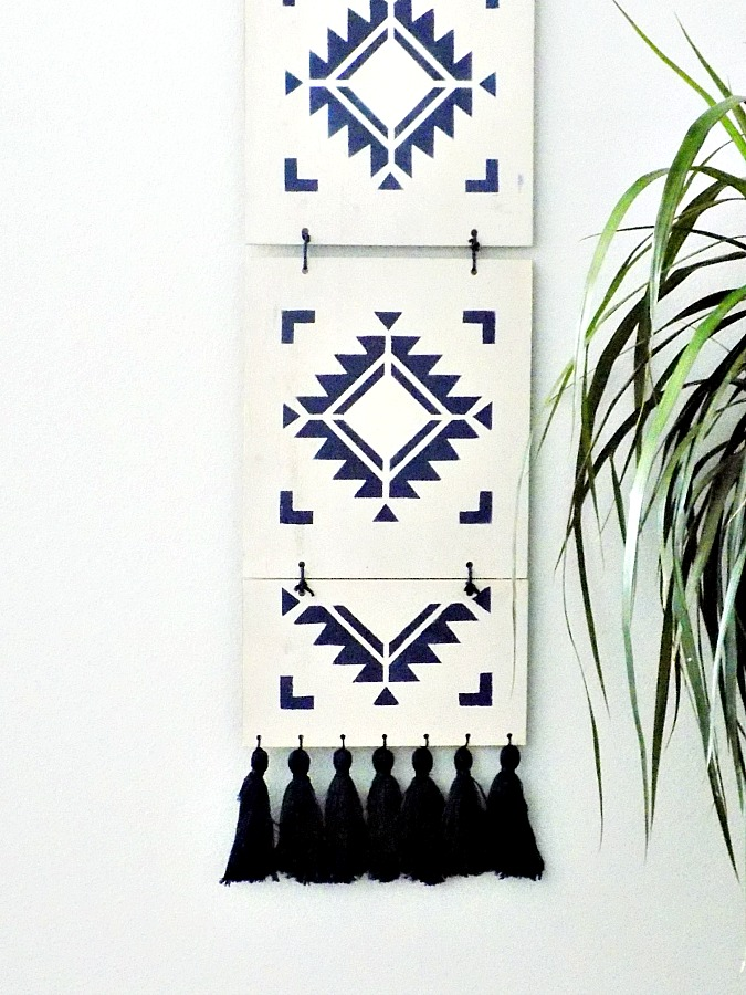 Boho wooden wall art with stencil and tassels