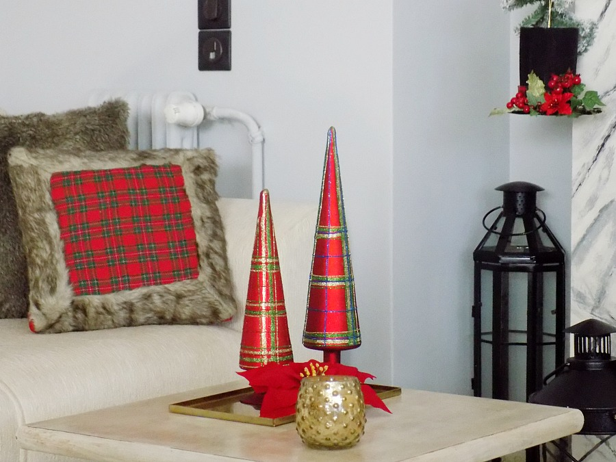 Coffee table christmas decor, red plaid pillow and trees