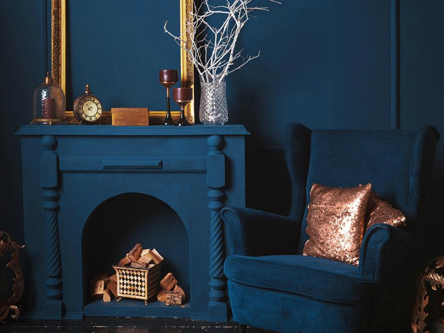 All over classic blue color, walls, fireplace, armchair