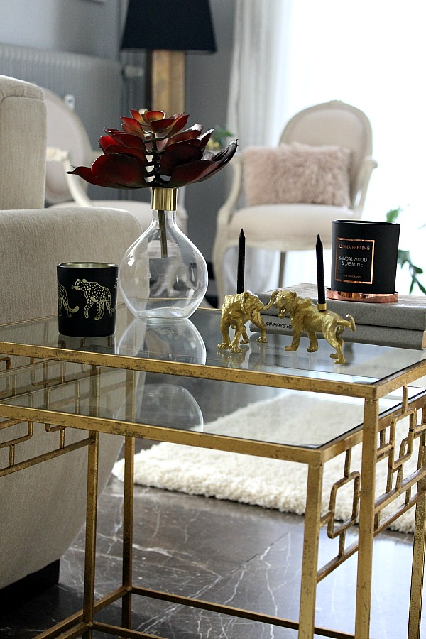 Gold metallic side table, plastic animals candle holders