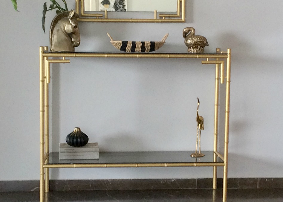 Ten ways to use baskets as decor and storage, metallic console table