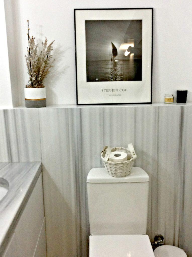 Master bathroom, white grey marble, white basket