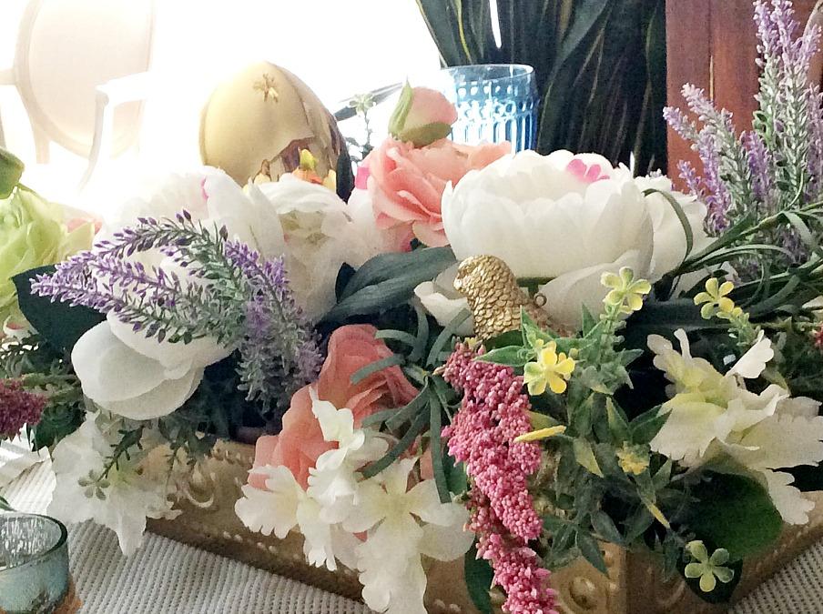 Faux flower arrangement, gold egg, gold bird