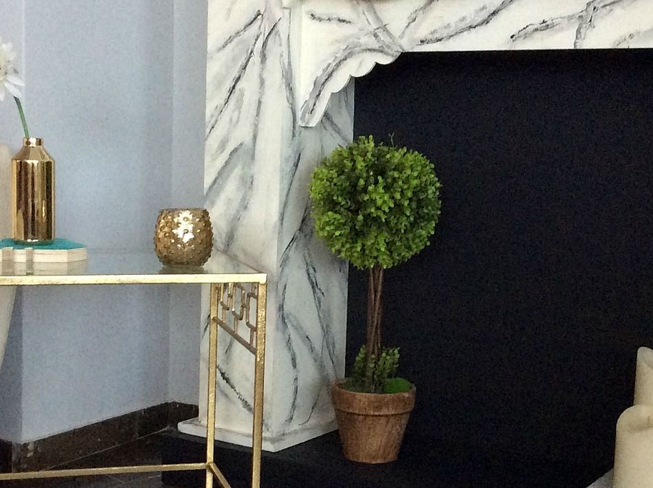 Faux topiary in the fireplace, summer decor