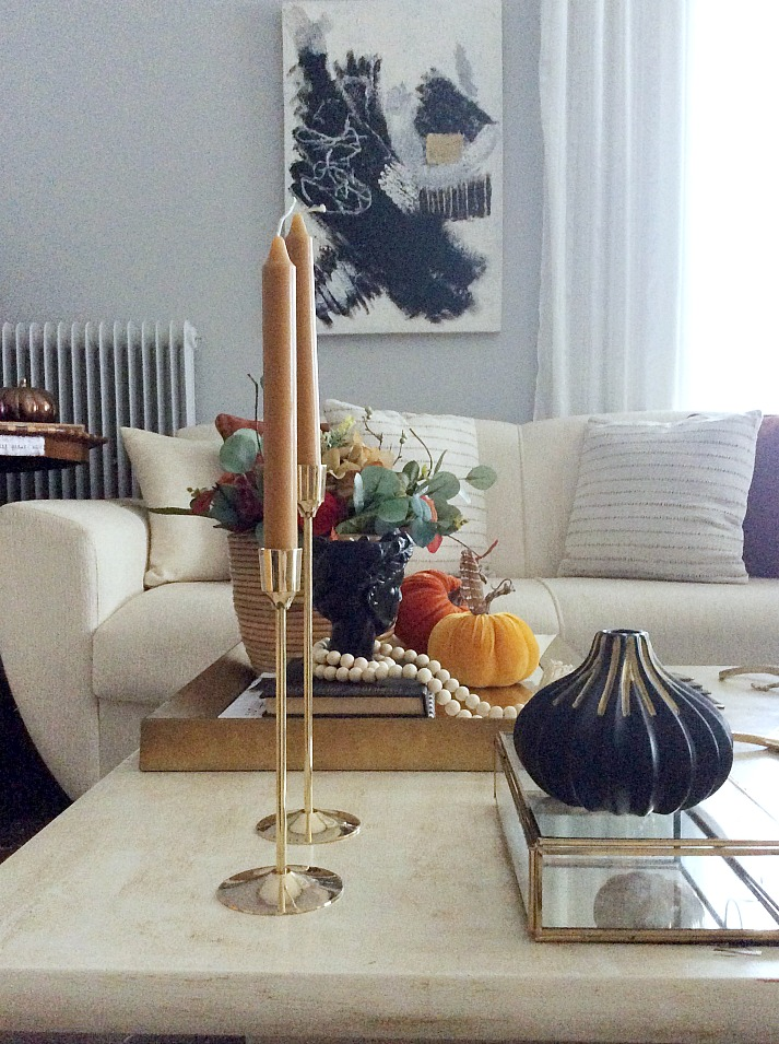Brass candle sticks, coffee table decor