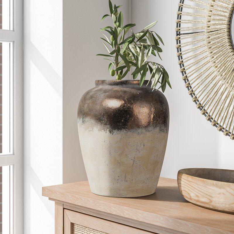 Brass and white ceramic vase